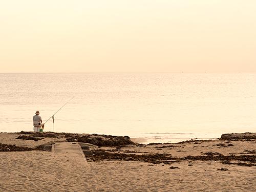 海の釣り師の高画質画像